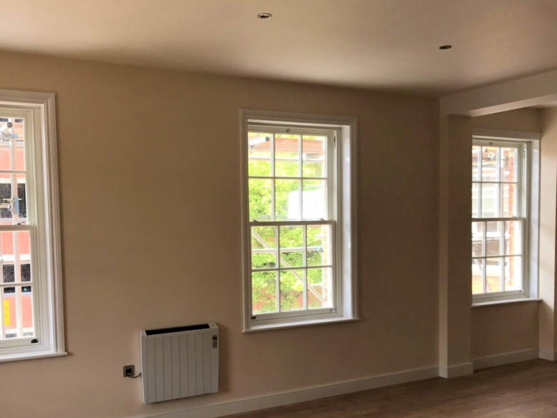 Fitting 134 timber windows and doors, Ipswich